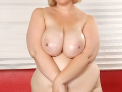Busty chubby blonde in black negligee flaunts tits and - Picture 6