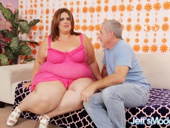 Chubby brunette in pink dress sucks cock as guy eats - Picture 1