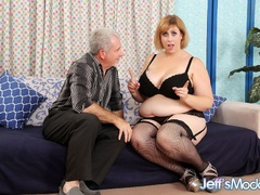 Chubby brunette in black lingerie measures cock, sucks - Picture 1
