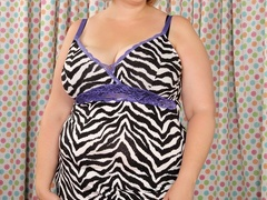 Plump brunette in stripped dress and black lingerie rubs - Picture 1