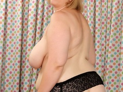 Plump brunette in stripped dress and black lingerie rubs - Picture 6