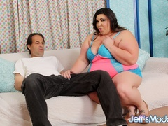 Plump sexy brunette in blue and pink negligee blows dick - Picture 1