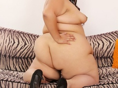 Big brunette in spotted negligee with pierced tits shows - Picture 8