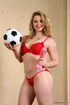Alluring blonde pose her steaming hot body in red…