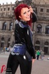 Alluring redhead displays her lusty curves and smoking hot body in public