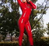 Gorgeous babe teases with her luscious curves wearing her red latex outfit