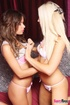 Blonde and brunette take each other's clothes, make out in the process.