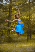 Stunning young dancer is getting naked in the forest