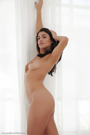 Black-haired young girl is lying naked o - XXX Dessert - Picture 2