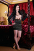 Black-haired goddess is getting naked and masturbating