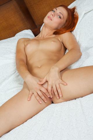 hot redhead spreads legs