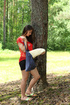 Brunette goes to the woods, fingers pussy while…