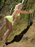 Smoking hot blonde teases with her steaming hot body in a valley wearing