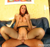 Brunette babe sucks and fucks dick on a black leather couch.