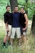 Gorgeous boys take off their blue and their black shirts then pose their
