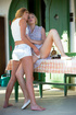 Girls undressing sexy dress and shorts to lick on table outdoor