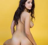 Wonderful young brunette poses on juicy lemon back ground