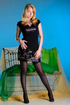 Blonde in stockings and pink corset pleasures self with ribbed pink dildo