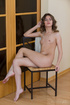 Classically beautiful young brunette strikes poses naked and shows her
