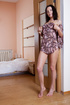 Slim brunette with big boobs speading her legs to show pussy in the bedroom