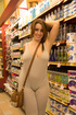 Young babe with a big ass walks around the market…