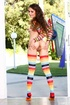 Cute babe in long rainbow socks and little tits…