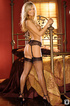 Fun blonde in black stockings lays gown in bed caressing her breasts and