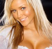 Honey-blonde, blue eyed bombshell with pierced ears, wearing lace sweater