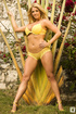 Busty blue-eyed blonde harlot in pretty yellow bikini with bracelet and