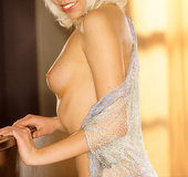 Hazel-eyed platinum blonde slut in pearl necklace and pretty silver lace