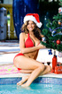 Christmas babe by the pool in santa outfit shows her juicy round breasts