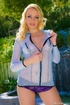 Bewitching blonde wearing a blue mesh shirt and purple panties makes a