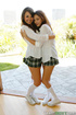 Two young lesbians in white socks and plaid skirts expose their bodies