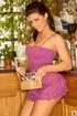 Busty brown-eyed brunette cook in cute purple mini-dress serves herself