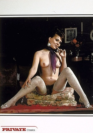 Lusty chick with smoking hot body wearing black stockings teases with her lusty boobs and sweet pussy as she pose naked on a white couch. Alluring babe bares her banging body with indulging tits and hairy pussy as she pose naked wearing her silver stockings. - XXXonXXX - Pic 12