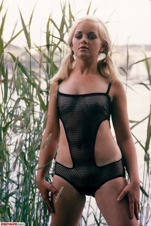 Blonde hottie in pigtails pose her luscious body by the lake wearing her sexy black fishnet bikini before she gets naked and expose her small tits and sweet pussy. - XXXonXXX - Pic 1