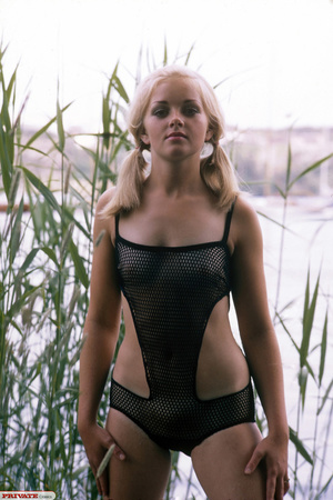 Blonde hottie in pigtails pose her luscious body by the lake wearing her sexy black fishnet bikini before she gets naked and expose her small tits and sweet pussy. - XXXonXXX - Pic 3