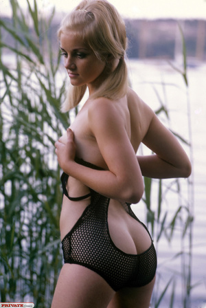 Blonde hottie in pigtails pose her luscious body by the lake wearing her sexy black fishnet bikini before she gets naked and expose her small tits and sweet pussy. - XXXonXXX - Pic 4