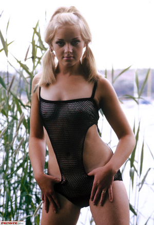 Blonde hottie in pigtails pose her luscious body by the lake wearing her sexy black fishnet bikini before she gets naked and expose her small tits and sweet pussy. - XXXonXXX - Pic 5