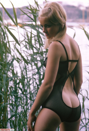 Blonde hottie in pigtails pose her luscious body by the lake wearing her sexy black fishnet bikini before she gets naked and expose her small tits and sweet pussy. - XXXonXXX - Pic 6