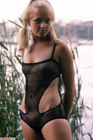 Blonde hottie in pigtails pose her luscious body by the lake wearing her sexy black fishnet bikini before she gets naked and expose her small tits and sweet pussy. - XXXonXXX - Pic 7