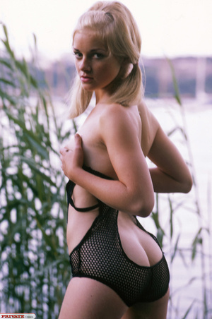 Blonde hottie in pigtails pose her luscious body by the lake wearing her sexy black fishnet bikini before she gets naked and expose her small tits and sweet pussy. - XXXonXXX - Pic 8