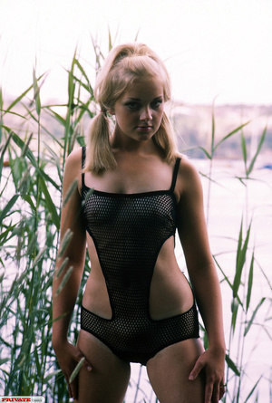 Blonde hottie in pigtails pose her luscious body by the lake wearing her sexy black fishnet bikini before she gets naked and expose her small tits and sweet pussy. - XXXonXXX - Pic 10