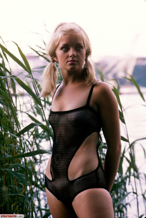 Blonde hottie in pigtails pose her luscious body by the lake wearing her sexy black fishnet bikini before she gets naked and expose her small tits and sweet pussy. - XXXonXXX - Pic 11