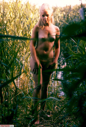 Blonde hottie in pigtails pose her luscious body by the lake wearing her sexy black fishnet bikini before she gets naked and expose her small tits and sweet pussy. - XXXonXXX - Pic 13