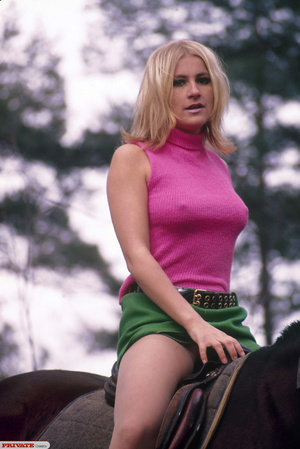 Luscious babe in pink shirt, green skirt, skin tone stockings and black high heels rides on a horse and displays her hot body before she shows her lusty ass in the forest. - XXXonXXX - Pic 7