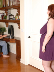 Redhead plumper takes off her purple blouse and expose - Picture 3