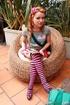 High heeled teen in striped socks took off her black bra and enjoying