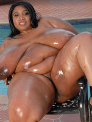 Humongous ebony bares her freaky enormous boobs wearing - Picture 6