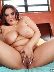 Fat hottie teases with her large body on a blue bed - Picture 6